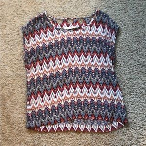 A zig zag shirt with neat cut-outs
